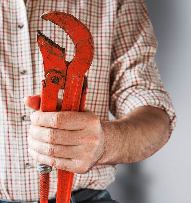 man holding adjustable wrench